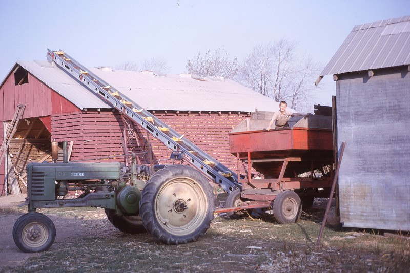 Ralph in wagon, loading corncrib, 1963-64