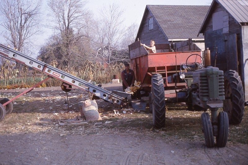 Ernie and Ralph loading corncrib, 1963-64